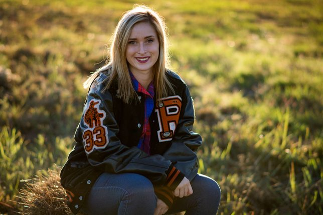 Our great niece Teddy Lauren Brown poses for a classic letter-jacket senior portrait Saturday evening in Duncan, Oklahoma. This image was made with one of my all-time favorite lenses, the AF-S Nikkor 85mm f/1.8, mounted on my Nikon D7100.