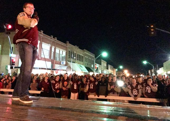 The Ada Cougars football team players and fans enjoy a pep rally on Main Street in Ada.