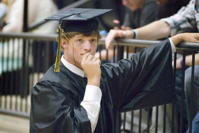 Ty Hoppe nervously chews on his tassel prior to Latta High School's first ever commencement ceremonies in their new multi-million dollar gym Tuesday evening, May 20, 2014. Though somewhat noisy at the D200's maximum ISO of 3200, the image still worked well.