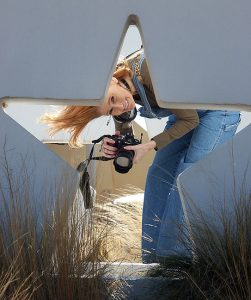 Abby holds her Nikon D70S as she smiles for me at a rest stop in the Texas Panhandle.