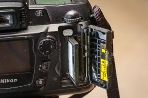 The D70S was one of the last, maybe the last, entry-level camera to use Compact Flash (CF) cards. THe D40, D40x, D50, D80, and D90 all use the much smaller, and equally capable, Secure Data (SD) cards.
