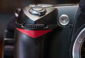 Most entry-level DSLR cameras don't include a second command dial, found on the right front of the camera under the right index finger. The reason for this is, along with removing the top LCD display, to save space and make very small cameras, but I use the second command dial every day.