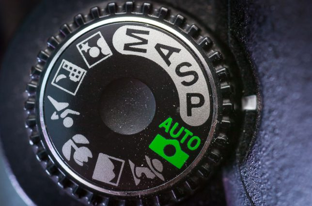 The Nikon D70S has a true exposure mode dial.