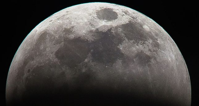 Details are visible in this images as the Earth's shadow creeps upwards on the face of the moon Sunday night, Jan. 20.