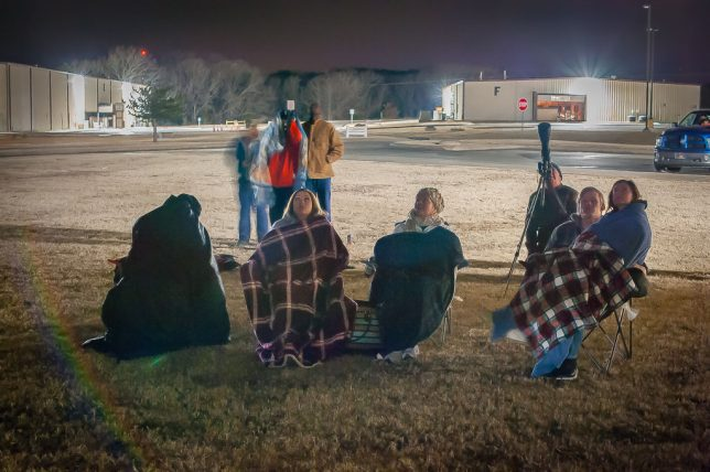 A group of intrepid sky gazers brave cold temperatures as they watch as the lunar Eclipse of Jan. 20, 2019 at the Pontotoc Technology Center.