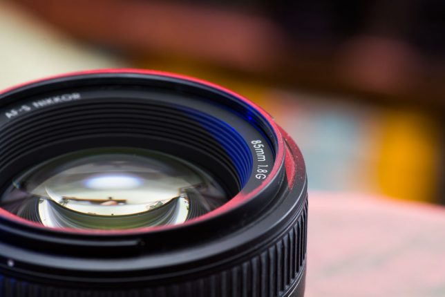 My AF-S 85mm F/1.8 Nikkor sits in my studio. It's a nice image of a great lens, but it feels weird not having a filter and a hood on it.