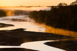 The sun rises over the Canadian River north of Byng. This image was made with a 70mm lens.