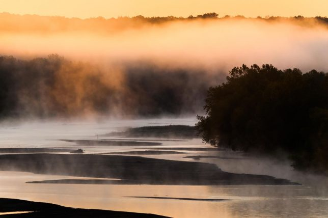 The sun rises over the Canadian River north of Byng. This image was made with a 300mm lens.