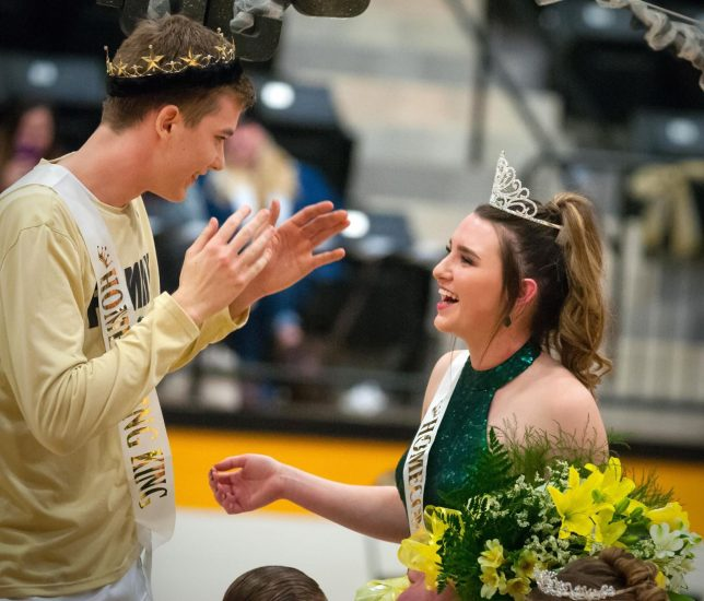 Latta Homecoming King Rylan Schlup and Queen Cheyenne Adair share a laugh during their crowning at Latta School's 100th anniversary celebration Friday, Jan. 17, 2020 at Latta Panther Fieldhouse.