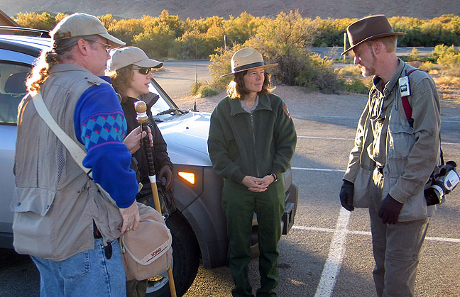 Members of our group visit with Park Ranger Annie Corson at the Delicate Arch trail head early in the morning of October 12.