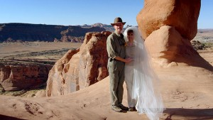 My wife and I pose under Delicate Arch just minutes after getting married.