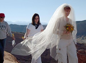 Abby commences the traditional wedding march. She hauled her veil from the trail head in her backpack.