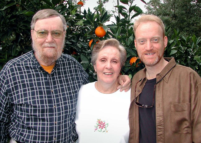 Dad, Mom and I pose in front of their Palm Coast, Florida, orange trees at Christmas 2002. The fruit trees were Christmas presents from years earlier, and over the years produced many oranges suitable for juicing.