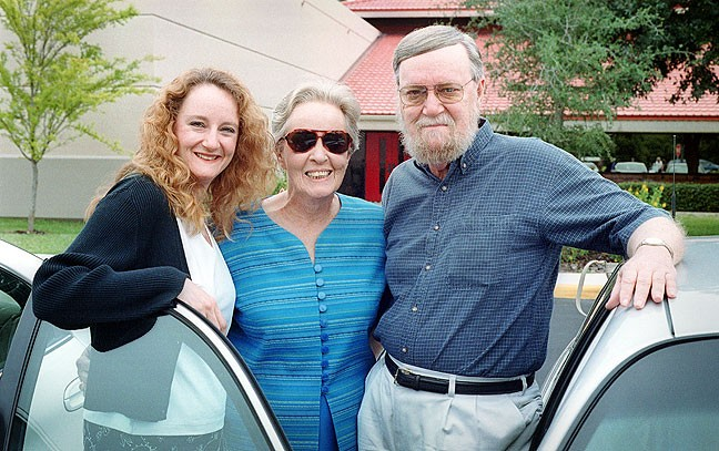 My sister Nicole, mother Sarah Jo, and father Joseph pose in front of the Saint Thomas Episcopal Church in Palm Coach, Christmas 2000.