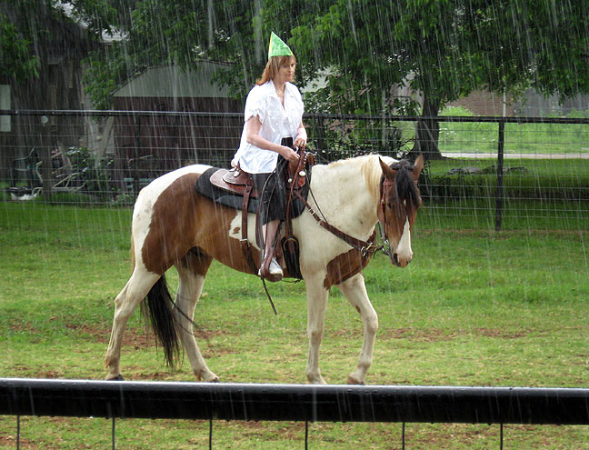 Abby rides Abe around the ring in a soaking downpour