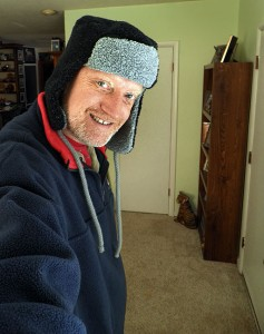 Preparing to Go Outside, Wearing the Coolest Ski Hat in the Universe