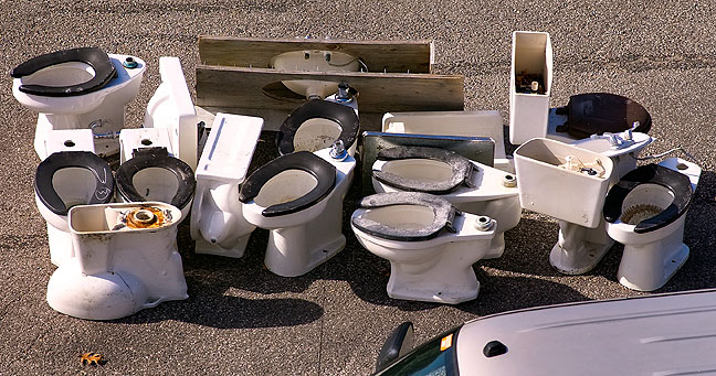 Pile of commodes awaiting auction; I doubt it will be the most lucrative sale of the day.
