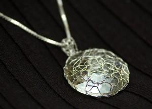 Abby's new crystal pendant