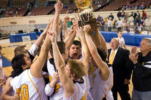 The Roff Tigers hoist their first gold basketball in more than six decades Saturday night, March 6, at the State Fair Arena in Oklahoma City