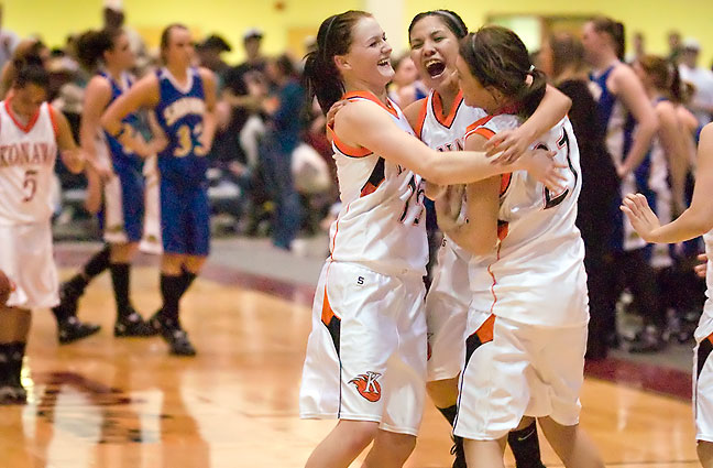 The Konawa Lady Tigers celebrate a 3-point victory against Savanna at the Expo Center in McAlester Friday night, March 5