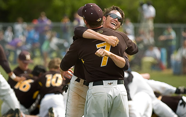 Aaron Cornell hugs assistant coach Danny Baldrige after the Tigers state championship victory in Oklahoma City this afternoon