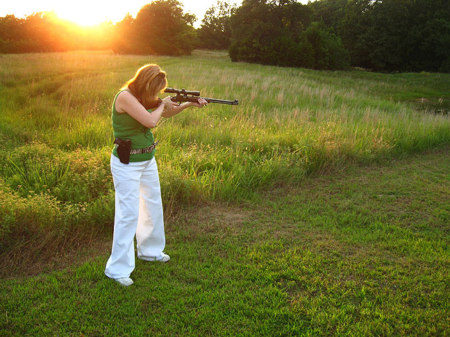 Green and gold hues paint the pasture at sunset as Abby takes a bead on a piece of PVC pipe I brought as a target