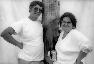 Frank and Marilyn Stinson in the late 1980s, posing with the totem pole Frank carved by hand (photo courtesy Robert Edison Stinson)
