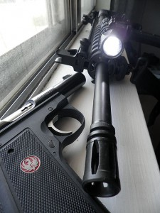 My Ruger Mark III and my Smith and Wesson M&P; note the flashlight on the tactical rail of the rifle, held there by zip ties, which worked as well as a pair of brackets.