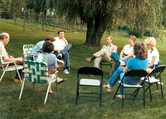 The family gathered in the back yard in Independence, Missouri; this was probably Memorial Day, about 1978. Note the enormous willow tree and the garden beyond.
