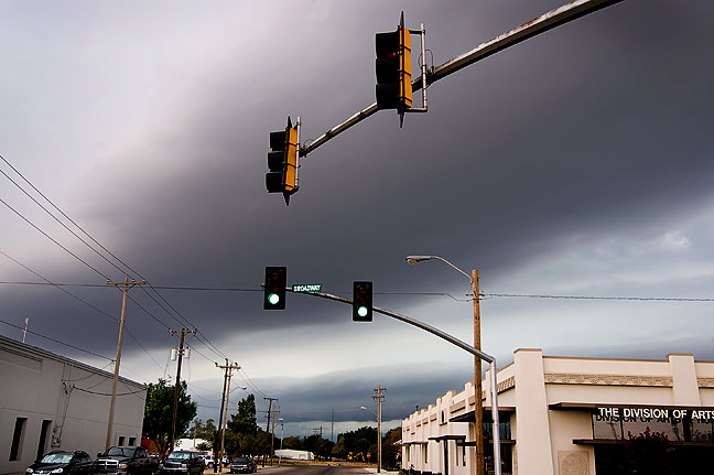 Two roll clouds move across downtown Ada this morning, a harbinger of a large area of rain that moved through by midday.