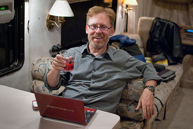 Robert makes himself at home and has a glass of juice in our RV tonight.