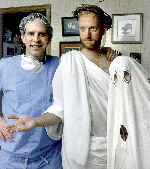 On the left is David Wheelock dressed in the hospital scrubs he wore the day his first daughter was born. I am in the middle dressed as Jesus. Brenda Wheelock is next to me in a ghost costume with a bunch of extra eye holes. The punch line? We are father, son and holy ghost.