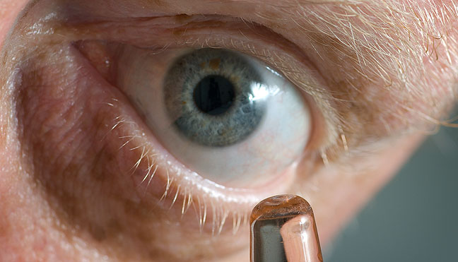 If you are grossed out by pictures of giant eyes, you probably shouldn't have looked at this one. It is mine. The object just in front of it is a ring holder I used as a focusing target.