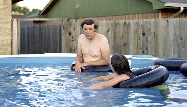 Dad and Nicole bob gracefully in the newly-installed pool in our back yard. It should be noted that neither my father nor I ever learned to swim.