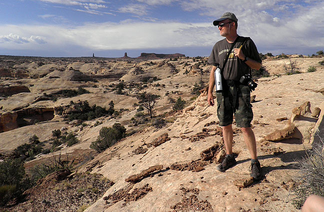 Your humble host hikes in the remote Maze District of Canyonlands National Park of southern Utah. (Photo by Dennis Udink)