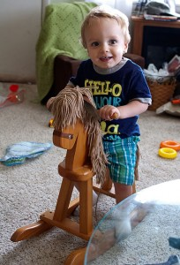 Our grandson Paul plays on his rocking horse in our living room. The horse is a family heirloom.