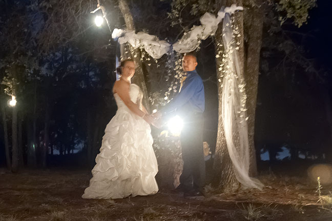 Newlyweds Justin Ashford and Mechelle Smith pose by candlelight after their wedding ceremony last night in Duncan, Oklahoma.