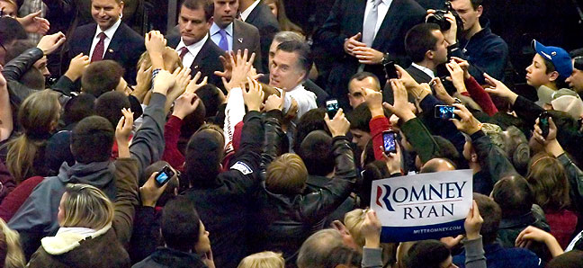 Mitt Romney greets his supporters at his final campaigne rally Monday night, Nov. 5, 2012, in Manchester, New Hampshire. (Photo by Robert Stinson)
