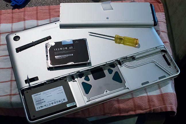 The hard drive on the 2009-era MacBook Pro is a cinch to replace. This shows the new SSD in place and ready to operate in about 90 seconds.