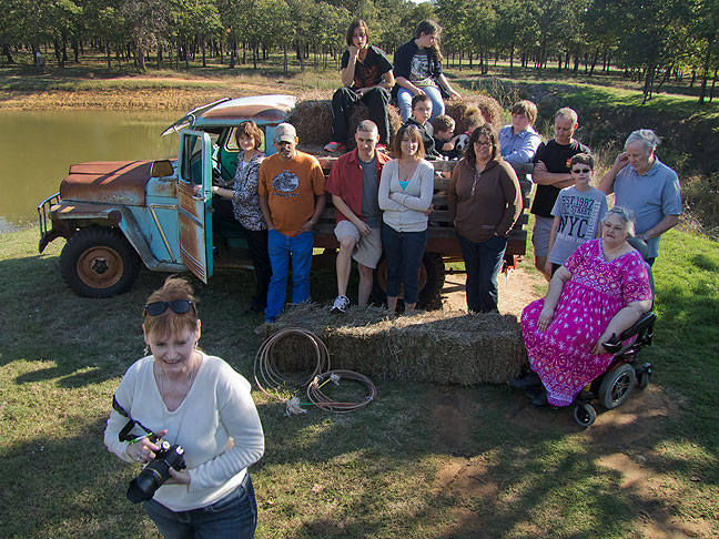 Abby, lower left corner, prepares to photograph her family with an old Jeep named Elmer at the Shoffner Family Reunion in October.