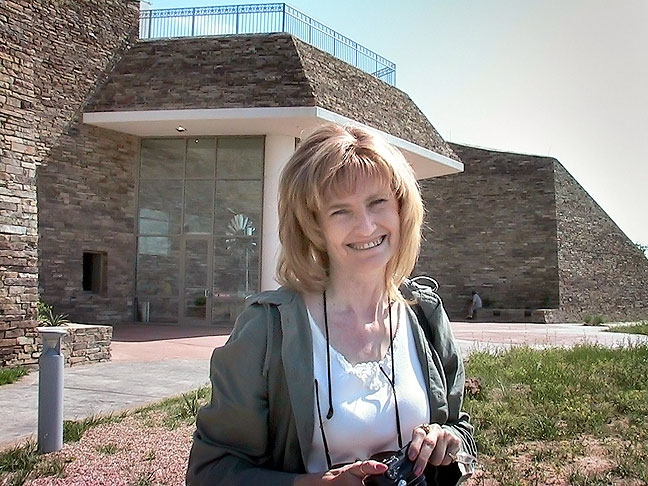 "Abby smiles at a rest stop in the Texas panhandle. On every trip out west since then, we refer to this as ""our"" rest stop."