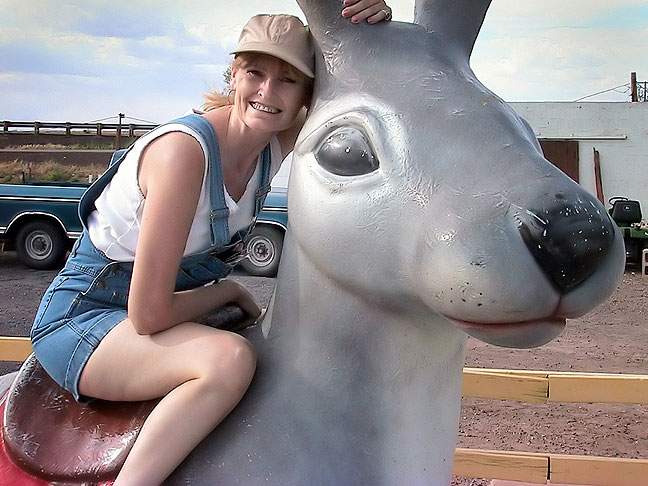 Abby Milligan poses on the giant jackrabbit on Interstate 40 near Winslow, Arizona, July 2003. 15 months later she became my wife.