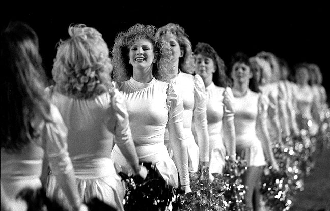 The Ada High School Couganns dance team take the field in this previously unpublished October 29, 1988 image. Everyone in this picture is in her 40s now.