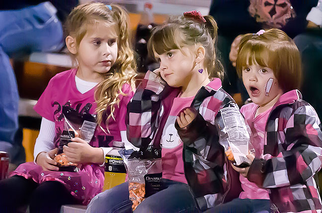 In one of my most recently published images, Dusty Westmoreland, Piper Kirkwood and Paylyn Kirkwood take a snack break at the Konawa vs Tishomingo football game in Konawa Thursday night, Oct. 17, 2013.