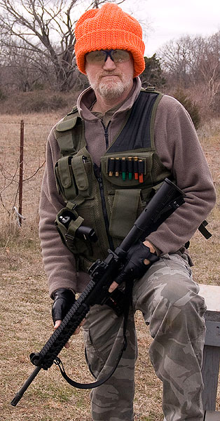 """This is me with an M&P 15/22. My sidearm is a Ruger 9mm pistol. Of note is the fact that one of the names of that cartridge is 9mm Parabellum, which literally means """"9mm for war."""""""
