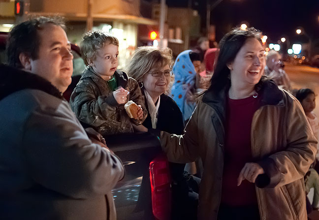 Tom, Paul, Abby and Chele watch tonight's 26th Annual Pat Taylor Memorial Parade of Lights.