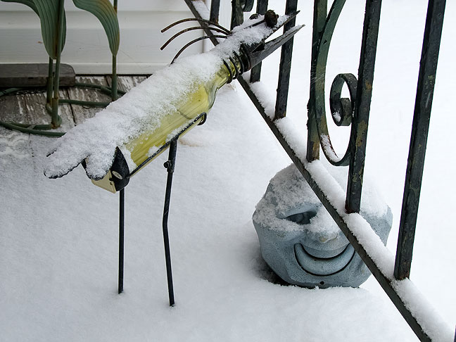 Snow clings to some of Abby's lawn ornaments on our porch this morning.