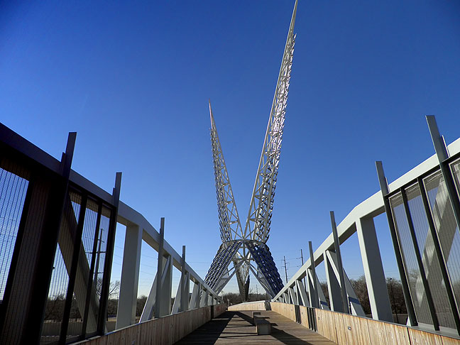 Oklahoma City's Skydance Bridge spans Interstate 40 near downtown. The steel sculpture above it represents the state bird, the Scissortail Flycatcher.
