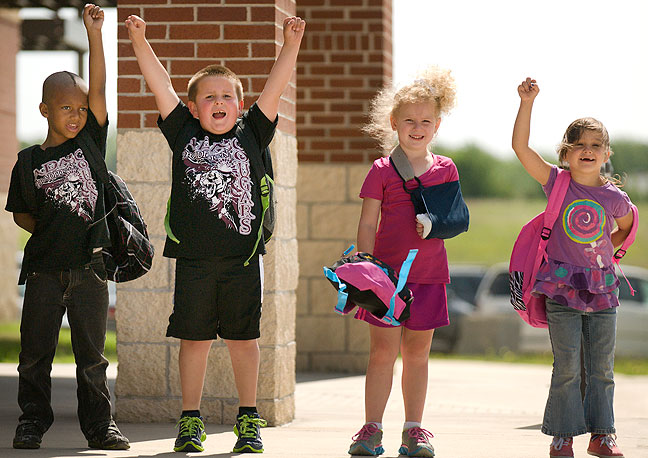 """Demarques Harris, Brylen Carpenter, Paisley Fancher and Juleah Martinez bid farewell to Ada Early Childhood Center as the 2014 school year comes to an end. My friend Loretta, a teacher at the school, organized this photo op for me. She said it was """"like herding cats."""""""