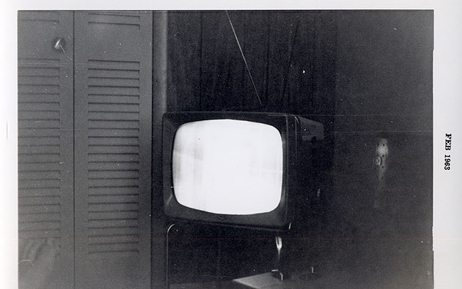This was Mom and Dad's first television, a 15-inch black-and-white, bought, according to the stamp on the photo, in February 1963, five months before I was born.